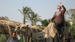 After lunch at an outdoor restaurant on the road to Sakkara, Leyla rides a camel