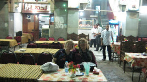 Leyla and I sitting in sidewalk cafe, watching the action on Husseyn Square
