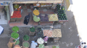 View from the balcony of Leyla's Giza apartment, of the colorful vegetable shop below