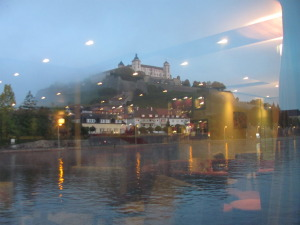 Dawn view of the castle at Würzburg, seen through the reflections of the lights in the ship's lounge