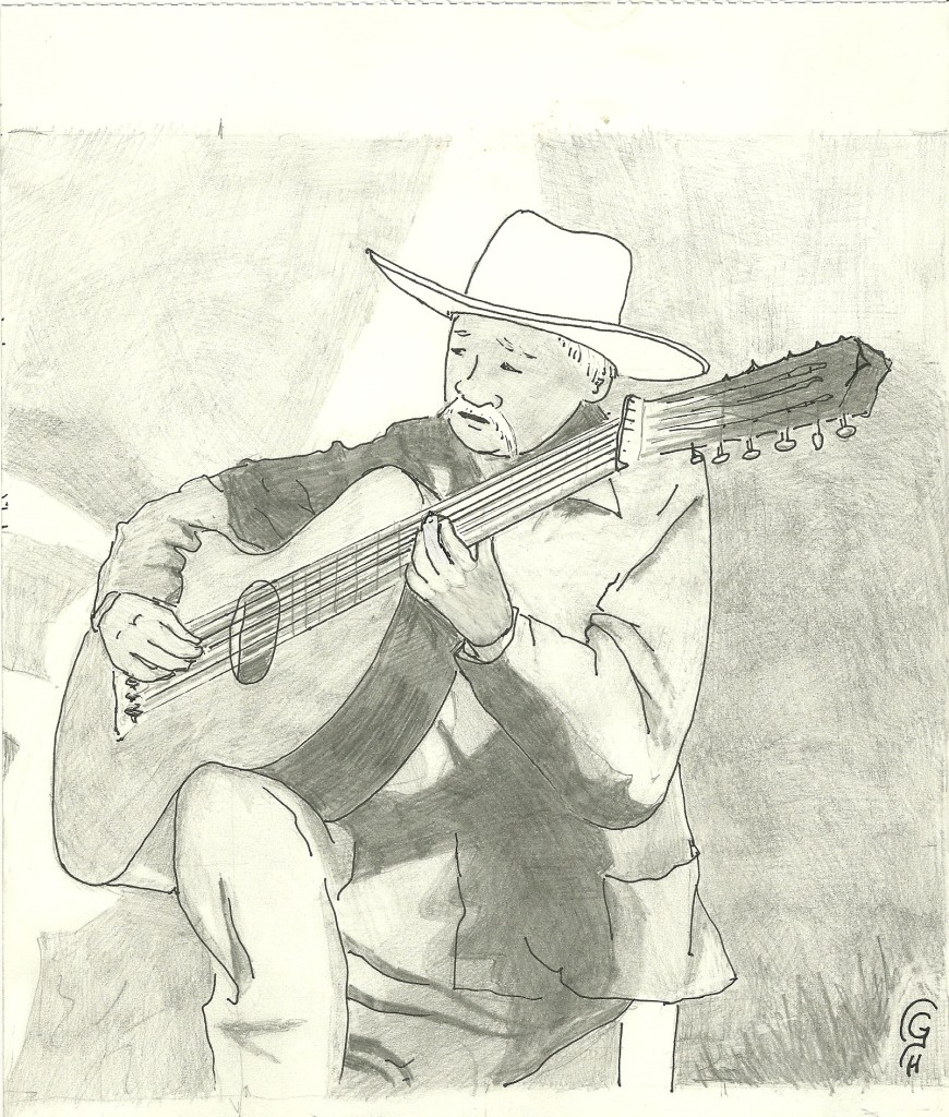 A Mexican musician singing corridos and playing the guitarron