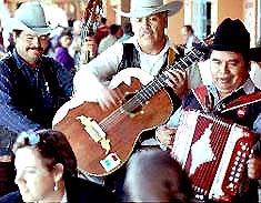 Los Alegros del Norte, a norteña group, playing in a marketplace