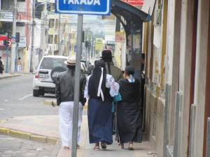 A family group walking toward the cathedral, on a quiet Sunday morning in Otavalo